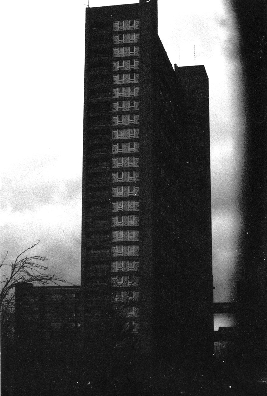 ICMSTUDIOS - A black and white photo of a tower block in London.