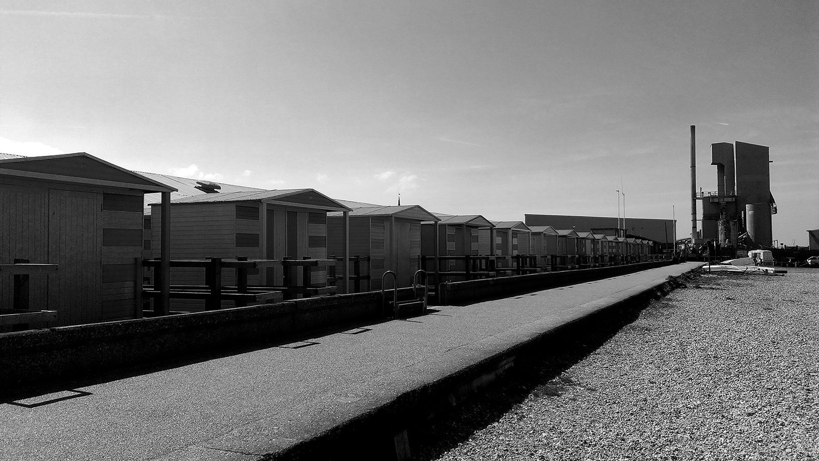 ICMSTUDIOS - A row of beach huts in Whitstable - near an aggregate plant!